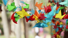 Stock Video Footage of Origami paper bird spinning in wind, handmade, Japanese art of paper.