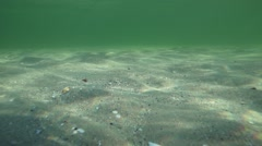 Sun reflected in the sea bed in slow motion Stock Footage