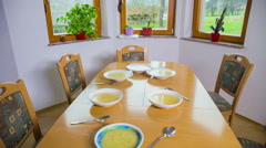 Kitchen table with soup jib shot - stock footage
