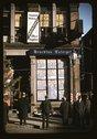 Men reading headlines posted in street-corner of Brockton Enterprise newspape Stock Photos
