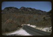 The road along the Skyline Drive, with a light snowfall in the rocks beside,  Stock Photos
