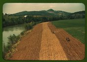 Planting corn along a river in northeastern Tennessee Stock Photos
