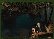 Boys fishing in a bayou, Schriever, La Stock Photos