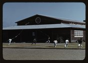 Boys flying a kite in front of community center, FSA ... camp, Robstown, Tex. Stock Photos