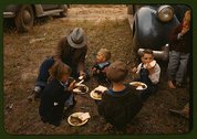 Homesteader and his children eating barbeque at the Pie Town, New Mexico Fair Stock Photos