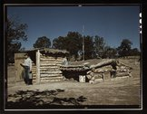 Mr. Leatherman, homesteader, coming out of his dugout home, Pie Town, New Mexico Stock Photos