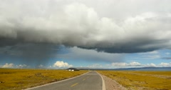 4k huge clouds mass rolling over namtso road,cars traveling on the road. Stock Footage