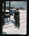 John Paulinski, car inspector, blue flagging a train for inspection, at Corwi Stock Photos