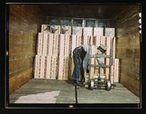Loading oranges into a refrigerator car at a co-op orange packing plant, Redl Stock Photos