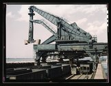 Unloading a lake freighter at the Pennsylvania Railroad iron ore docks by mea Stock Photos