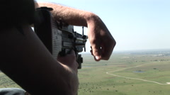 Cradling machine gun on a flying helicopter gunship - stock footage