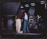 Installing an engine at the Consolidated Aircraft Corporation plant, Fort Wor Stock Photos