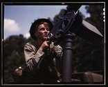 Good man, good gun: a private of the armored forces does some practice shooti Stock Photos