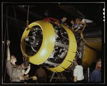 Mounting motor [on a] Fairfax B-25 bomber, at North American Aviation, Inc.,  Stock Photos
