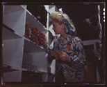 Clerk in one of the stock rooms of North American Aviation, Inc., checking to Stock Photos