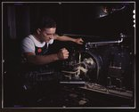In North American's modern machine shop, another aircraft part is finished on Stock Photos