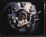 Part of the cowling for one of the motors for a B-25 bomber is assembled in t Stock Photos
