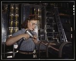 Operating a hand drill at the North American Aviation, Inc., [a] woman is in  Stock Photos