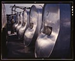 Bomb bay gasoline tanks for long flights of B-25 bombers await assembly in th Stock Photos
