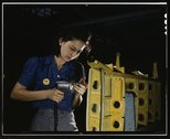 Drilling horizontal stabilizers: operating a hand drill, this woman worker at Stock Photos