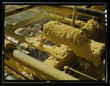 Melted sulphur from the wells pouring into relay station, Freeport Sulphur Co Stock Photos