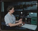 Working with the electric wiring at Douglas Aircraft Company, Long Beach, Calif. Stock Photos