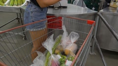 Female Customer at Supermarket with Shopping Cart Stock Footage