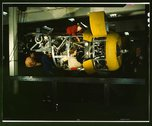 Installing one of the 4 motors on the transport plane at Willow Run Stock Photos
