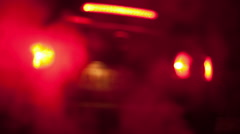 Background of red car lights and steam from the exhaust pipe Stock Footage