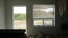Wrecked motel room. Interior. Truck passes. Stock Footage
