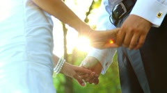 Stock Video Footage of young couple holding hands standing together in park. happy sunset people
