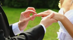 closeup of bride and groom exchanging wedding rings. happy people - stock footage