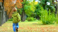 Cute 4 year old little boy running away in park. beautiful child. happy people Stock Footage