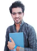 Closeup / portrait of a young indian / asian male college student on isolated Stock Photos