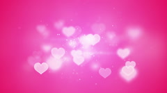 Pink heart shapes bokeh loopable romantic background Stock Footage