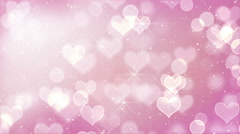 Pink heart bokeh lights and stars loopable Stock Footage