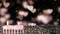 Two candles and heart bokeh lights loopable background Stock Footage