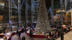 Shoppers visit the mall in VILNIUS, LITHUANIA Christmas Fair Stock Footage