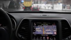 GPS navigator and View From Inside Car to street Stock Footage