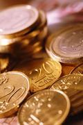 Euro coins on euro notes Stock Photos