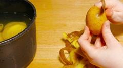 Peeling potatoes Stock Footage