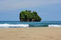 small island off a caribbean beach in costa rica - stock photo