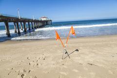 forbidden sign at beautiful hermosa beach in california - stock photo
