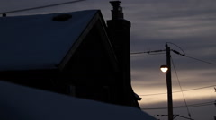 Winter sky with street light and time lapse clouds. Stock Footage