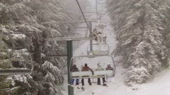 Ski Lift riding in snowy mountains - stock footage