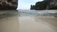 Beach at low tide near the rock - stock footage