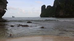 Beach at low tide near the rock Stock Footage