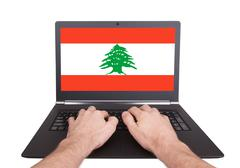 Stock Photo of hands working on laptop, lebanon
