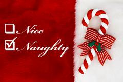 naughty or nice - stock photo