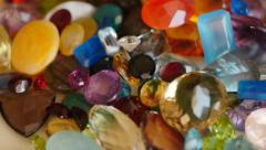Mail hands pour out colored precious gemstones 4k 2 Stock Footage
